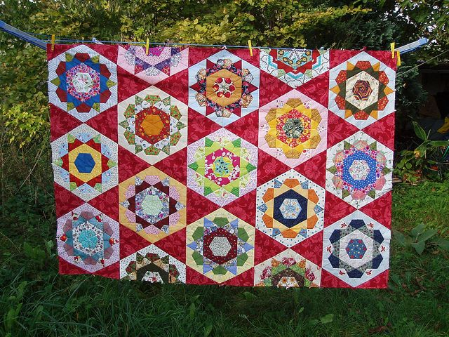 An old quilt always makes me smile because I think of the many quilts my grandmother made throughout her life :)