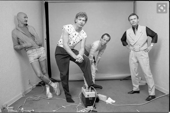 Personally, my favorite incarnation of King Crimson: from left to right, Tony Levin (bass, Chapman Stick, occasional synth-hookup), Bill Bruford (drums, percussion), Adrian Belew (guitar, vocals, lyricist), and Robert Fripp (guitar, Frippertronics).