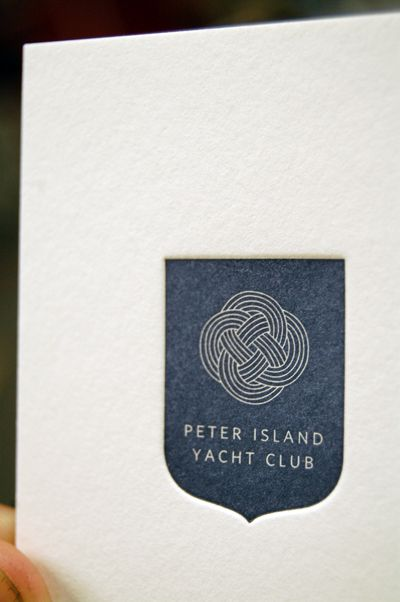 letterpress branding - reversed white type   Peter Island Yacht Club logo (printed by Mama's Sauce)