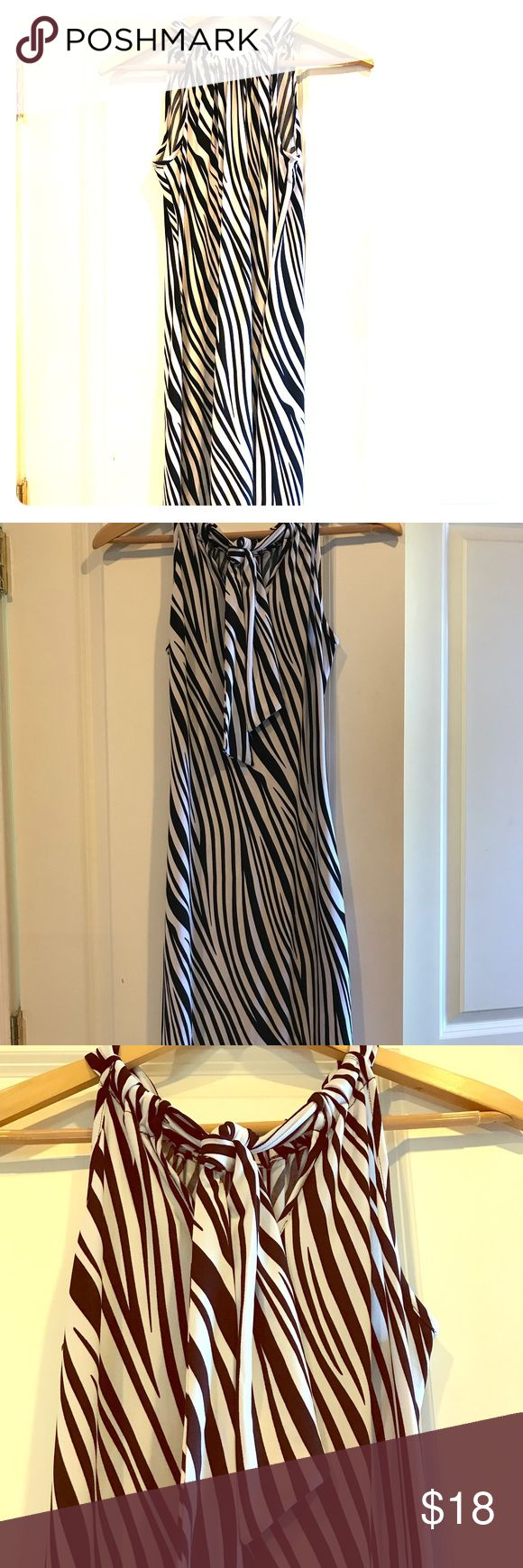 Black House White Market Zebra print dress Super cute Black House White Market Dress Size Small. Ties adjust at back for perfect fit. Worn 1x to a wedding. Great condition. No rips or stains. White House Black Market Dresses