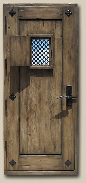 Studio Side Door with Operable Shutter (Back) Constructed with reclaimed Douglas fir.  Fitted with an antique iron window grill, clavos with escutcheons and cast bronze door latch. 10062-02 Graham