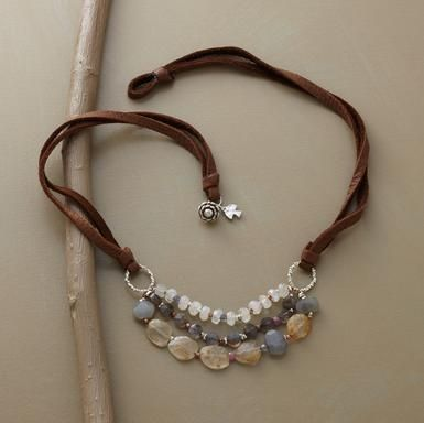 Beaded sterling silver links suspended on strips of suede, three strands form a enclave of gemstones. Copper beads glow among pink sapphires, grey and rainbow moonstones, labradorites, rutilated quartz and iolite. $185.00 #bohemian