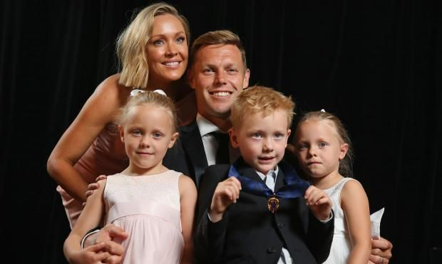 Sam Mitchell (pictured with his family) awarded the 2012 Brownlow.