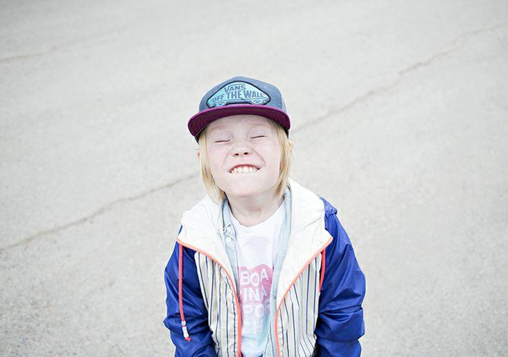 A boy wearing Vans cap.