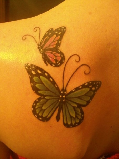 I want this with my mom's butterfly as green and mine purple with both having swallow tails.