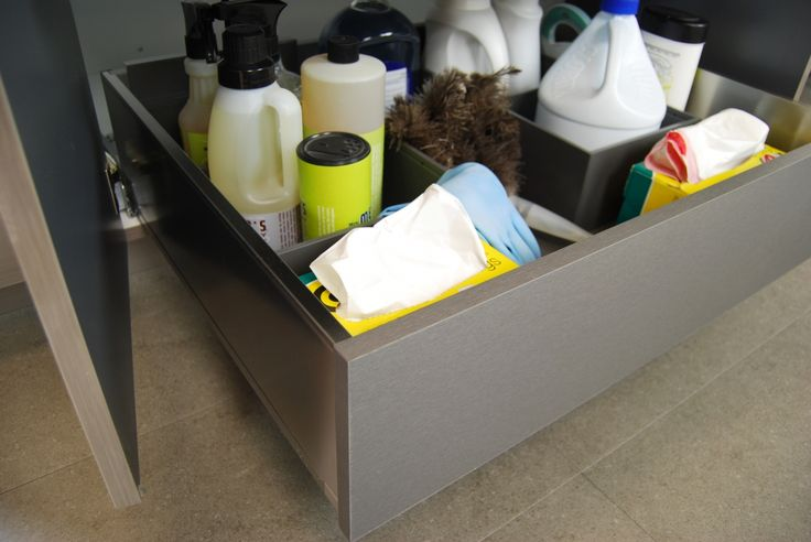 Solving Sink Storage in the Bathroom: Dura Supreme Roll-Out shelves are also available in Stainless Steel as well as Maple. They are a great option for creating more usable storage under the sink.