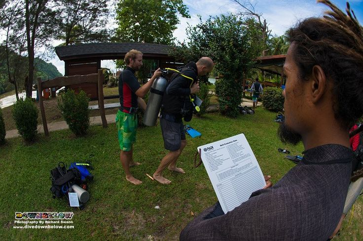 IDC Staff local Go PRO intern, and one of our full time PADI Instructors, evaluates Carl and Dominik assisting each other into their dive gear :)