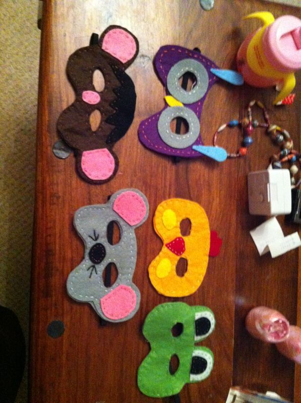 Handmade felt masks for birthday party dress-ups or party favours.