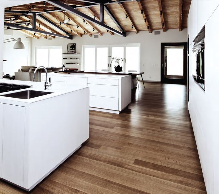Floor Muffler Kitchen Contemporary with Double Islands Exposed Beams Fitucci Cabinets Floating Shelves Minimalist Open Kitchen Sloped