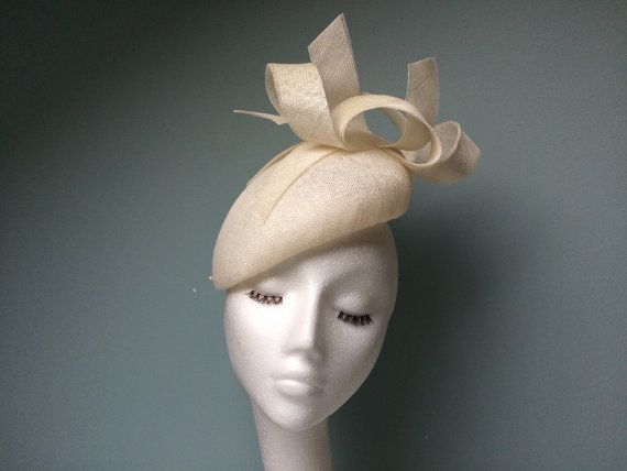 Ivory Fascinator Beret Hatinator with Feather Arrow. Materials: sinamay, elastic, feather, petersham ribbon
