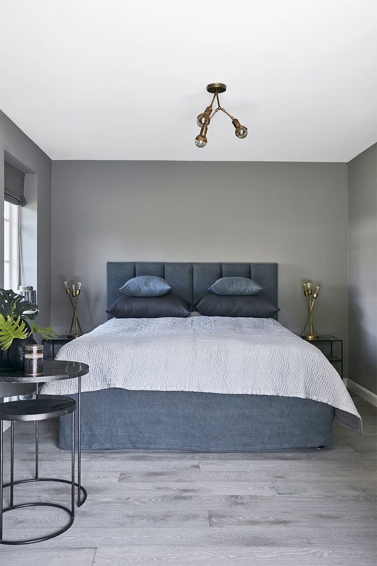 The dusty blue bedroom with the brass lamps almost look like something you would see at a hotel.