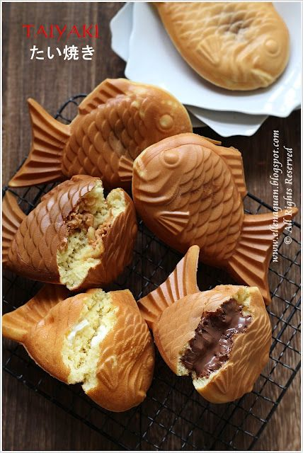"たいやき Taiyaki  "" Japanese fish-shaped cake. The most common filling is red bean paste that is made from sweetened azuki beans. Other common fillings may be custard, chocolate, or cheese. Some shops even sell taiyaki with okonomiyaki, gyoza filling, or a sausage inside."""