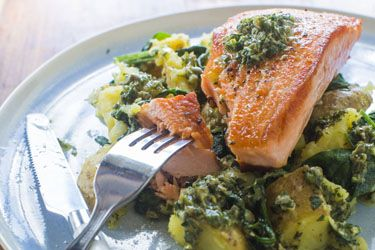 Salmon with salsa verde, smashed potatoes and spinach