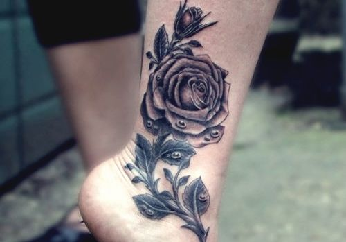 http://www.tattooesque.com/black-rose-ankle-tattoo/