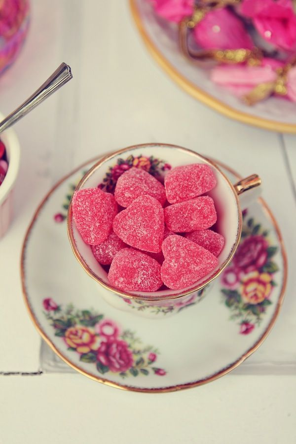 Candy hearts in teacups