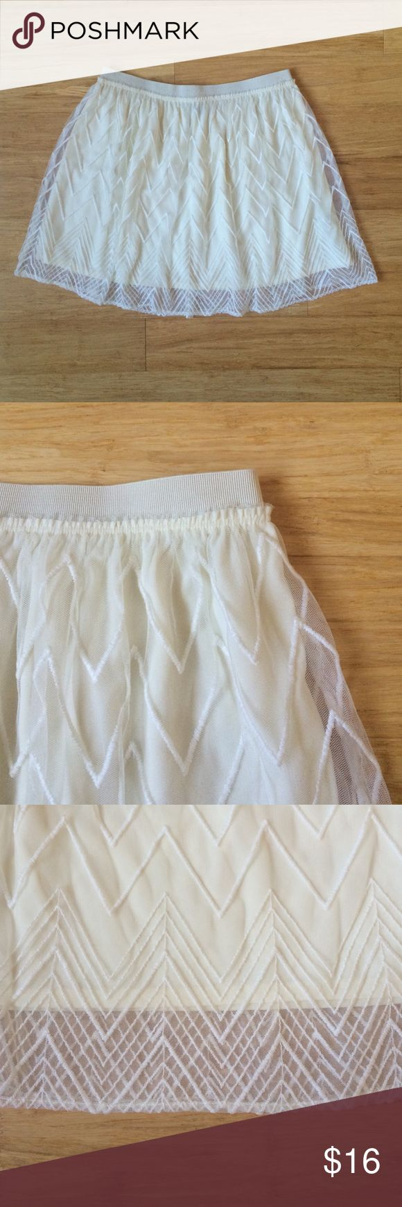 """Chevron Skater Skirt Size Small Gently used skater skirt from American Eagle. Size small. Outer layer is cream, nylon mesh with all-over chevron embroidery. Lining is cream, polyester knit. Elastic waistband, pull-on style (about 29""""). No rips or stains. Worn two times at most! American Eagle Outfitters Skirts Circle & Skater"""