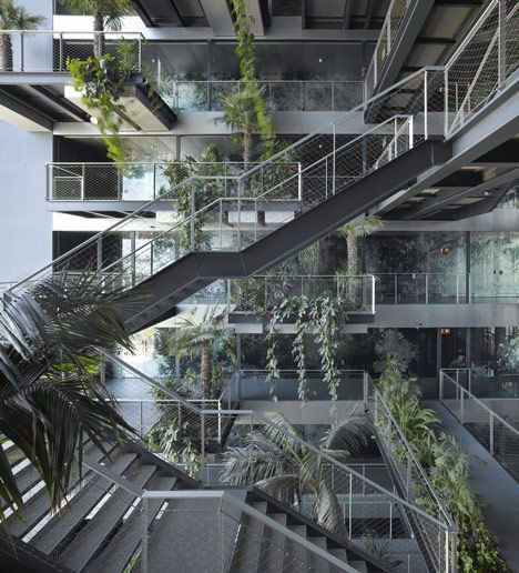 Hotel by Jean Nouvel has leafy windows and a plant-filled atrium