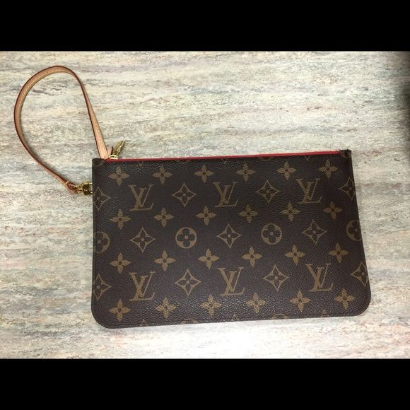 Louis Vuitton wristlet This is a cute wristlet that great for going out. Can hold a phone and cash and cards. This great wristlet is also divided into 2 compartments. Louis Vuitton Bags Clutches & Wristlets