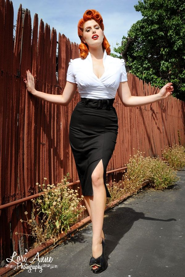 Vogue Skirt in Black - This high-waisted, mid-calf red pencil skirt will accentuate your curves with a snug fit and a generous walking slit.  Featuring princess seams, a size zipper and a wide belt, you'll feel great in this style anywhere from the office to the dance floor!  Made from high quality stretch cotton, and falls about 32.5 inches from natural waist to hem.