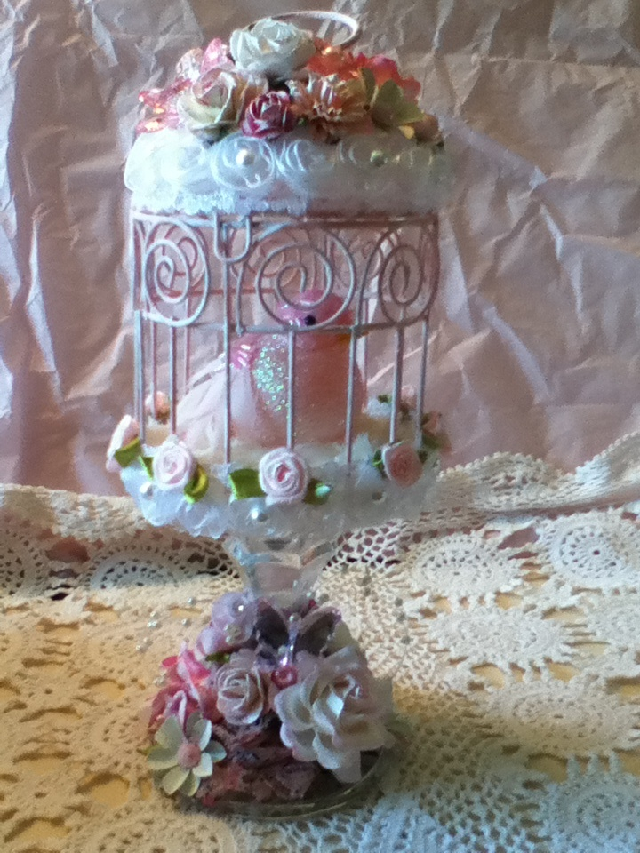 Altered bird cage. Shabby chic./ use jill rosettes and pearl ribbon on top and bottom, then white ribbon with rosettes, layer top with diy satin flowers. same on bottom of candle holder