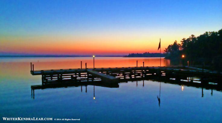 Kabetogama Lake Sunrise, Voyageurs National Park. Beautiful sunrise overlooking the dock at the Voyageurs Sunrise Resort in Voyageurs National Park. #kabetogama #voyageursnationalpark #northernminnesota writerkendraleah.com