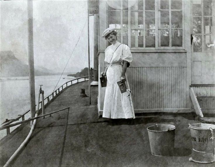 """1905 ... Marked """"Woman passenger on the deck outside the Pilot House on a steamboat (unnamed) in La Crosse, Wisconsin"""" .."""