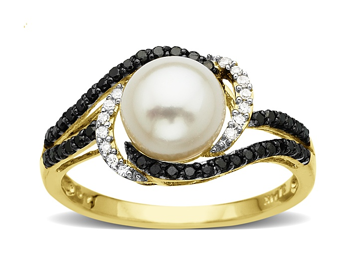A striking piece to shake up your conceptions of pearls. A single 7.5 mm freshwater pearl is caught in a striking eddy of black and white diamonds totaling 1/4 ct set in a delicate 14K gold band.Ring is a size 7.