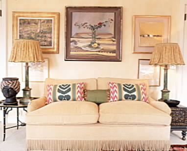 Contemporary Paintings hang behind a traditional sofa each enhancing the other.