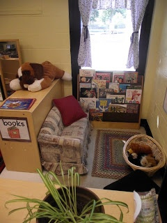 """comfy just right size couch for the kids in a small corner of the room- great idea... to allow students to """"get away"""" with their books"""