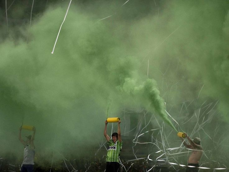 Colombian Atletico Nacional's supporters cheer for their team before the start of their Copa Sudamericana football match against Paraguay's General Diaz at the Atanasio Girardot stadium in Medellin, Antioquia department, Colombia