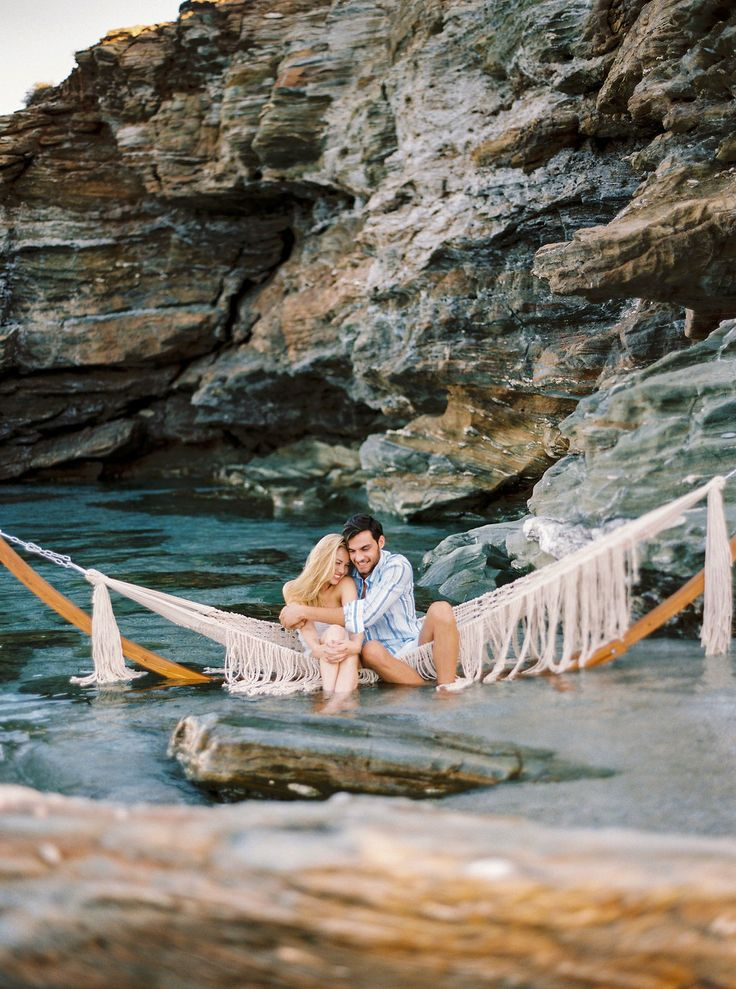 Want to Elope by the Sea? This is Where You Should Do It. Photo by Thecablook Fotolab - Concept, planning & design by I Wish Chic Events - Videography by Nikos Fragoulis - HMUA by Marylou Tzivelekis - Models: Michaela Pospisilova & Okan Boz - Styling by Spyros Savvinos -Macrame hammock by Boho choco