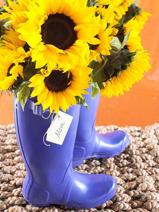 Place sunflowers in a cute pair of garden boots -they make an adorable Mother's Day gift! More  Mother's Day Flower Arrangements: http://www.bhg.com/holidays/mothers-day/gifts/mothers-day-flowers-ideas/?socsrc=bhgpin043012mothersdayflowers