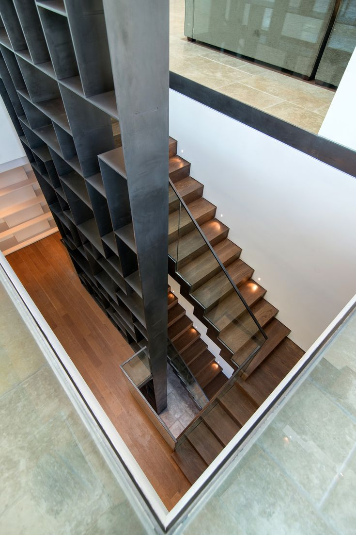 Modern Stairs // dark steel book wall wrapping the wooden library stairs from above at the Mamilla Residence | Matti Rosenshine Architects; Ilan Nahum | Archinect