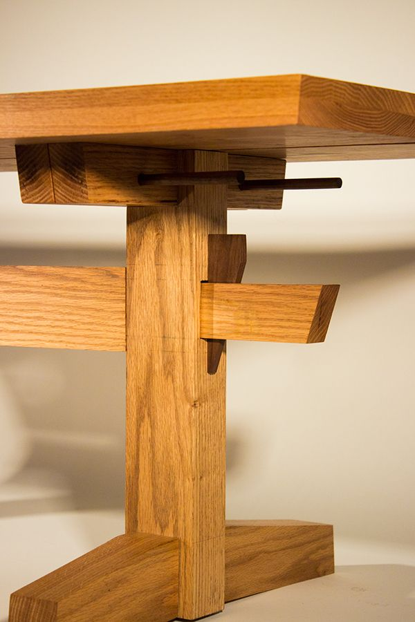 This is a shaker and japanese inspired trestle table. It can be  disassembled into four