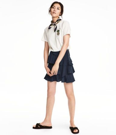 Dark blue. Short skirt in airy woven fabric with flounces. Visible zip at side. Unlined.