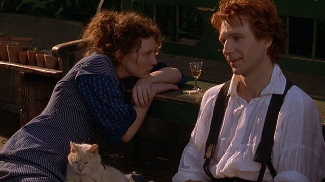 Lucinda (Cate Blanchett) and Oscar (Ralph Fiennes) strike up a unique friendship, along with Lucinda's ginger tabby cat, in Oscar and Lucinda (1997).