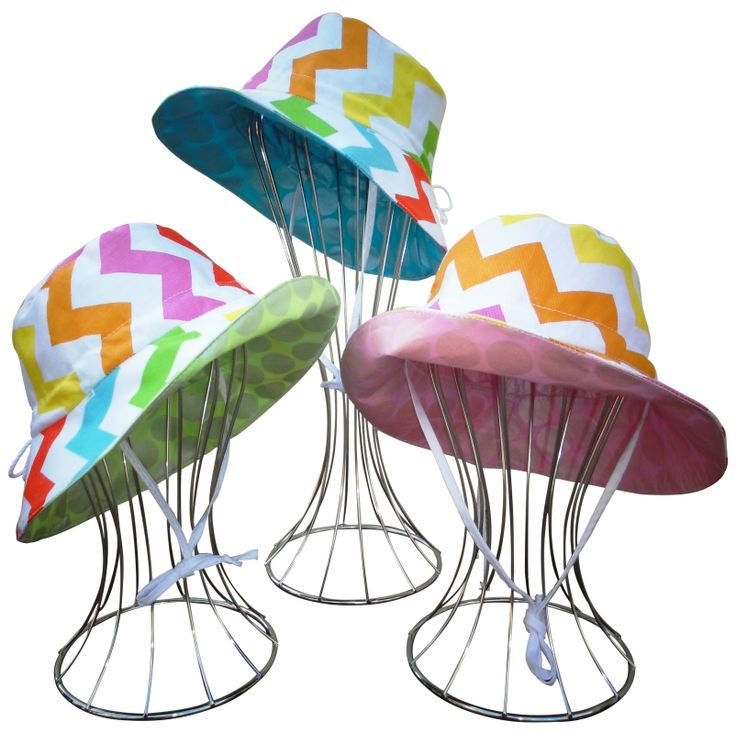 Rainbow Chevron collection; Also feature contrasting bright coloured reverse side prints of shiney pink/blue or green.   These hats are fully reversible. Adjustable to head size and Have an underchin tie to keep it on, even on windy days.  Available from www.ejkids.com.au  Sizes Newborn to 10Yrs