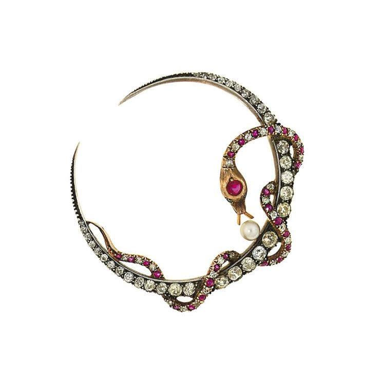 A late 19th century diamond, ruby, synthetic ruby, paste and cultured pearl brooch - Modelled a graduated old brilliant-cut diamond crescent with entwined old-cut diamond and vari-cut ruby and synthetic ruby serpent with green paste eyes, and later single cultured pearl accent, mounted in silver and gold, circa 1890.