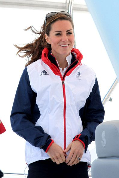 Catherine, Duchess of Cambridge, enjoys going sailing and meeting Ben Ainslie and the rest of Team Great Britain in Weymouth, England during the 2012 London Olympics. The Duchess wears Olympic gear including a red, white and blue windbreaker and red sneakers.