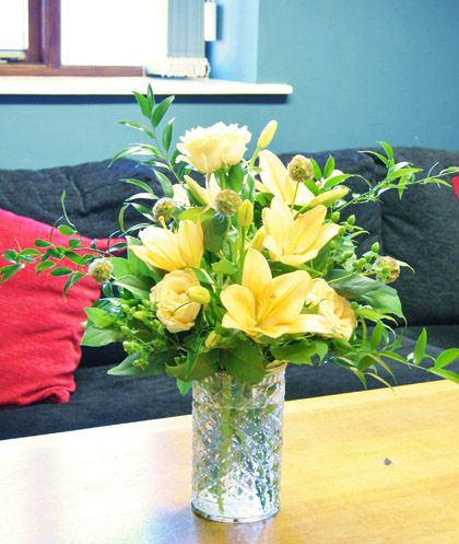 Florissimo, Shropshire. Bright corporate floral display for an office or venue reception area. (£25, as at 2016, vase loaned)