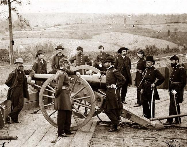 *GENERAL WILLIAM T. SHERMAN~ leaning on breach of gun, and staff at Federal Fort No. 7. The picture shows War in the West. These photographs are of Sherman in Atlanta, September-November, 1864. After three and a half months of incessant maneuvering and much hard fighting, Sherman forced Hood to abandon the munitions center of the Confederacy. Sherman remained there, resting his war-worn men and accumulating supplies, for nearly two and a half months.