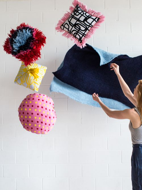 Daisy Watt - RMIT Textile Design. Pillows and Waffle blankets including handwoven fabrics, trims, double weave, Jacquard and dying techniques.
