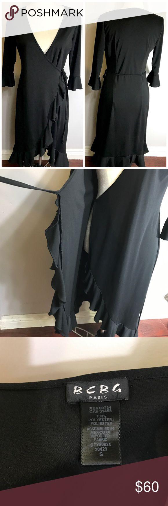 Bcbg Paris Black Wrap dress This dress is so pretty! It has half Bell sleeves. Ruffle trim. Bcbg Paris Dresses