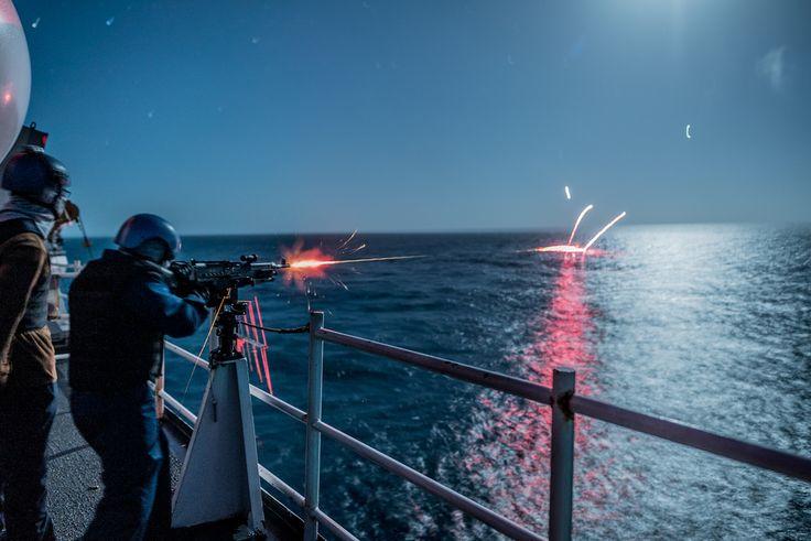 U.S. Coast Guard members practice shooting the M240 machine gun during a deployment aboard Coast Guard Cutter Stratton. U.S. Coast Guard photo by Petty Officer 1st Class Bryan Goff.