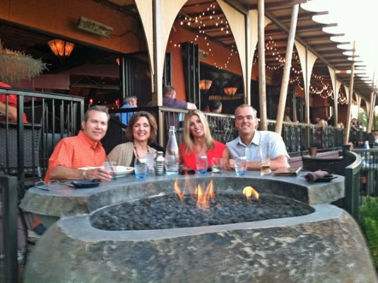 "Enjoying Dinner at the Fire Pit Table hand cut from a river boulder, plumbed with natural gas.  Made custom for ""Barbacoa"" restaurant by Impact Imports of Boise & Philadelphia."