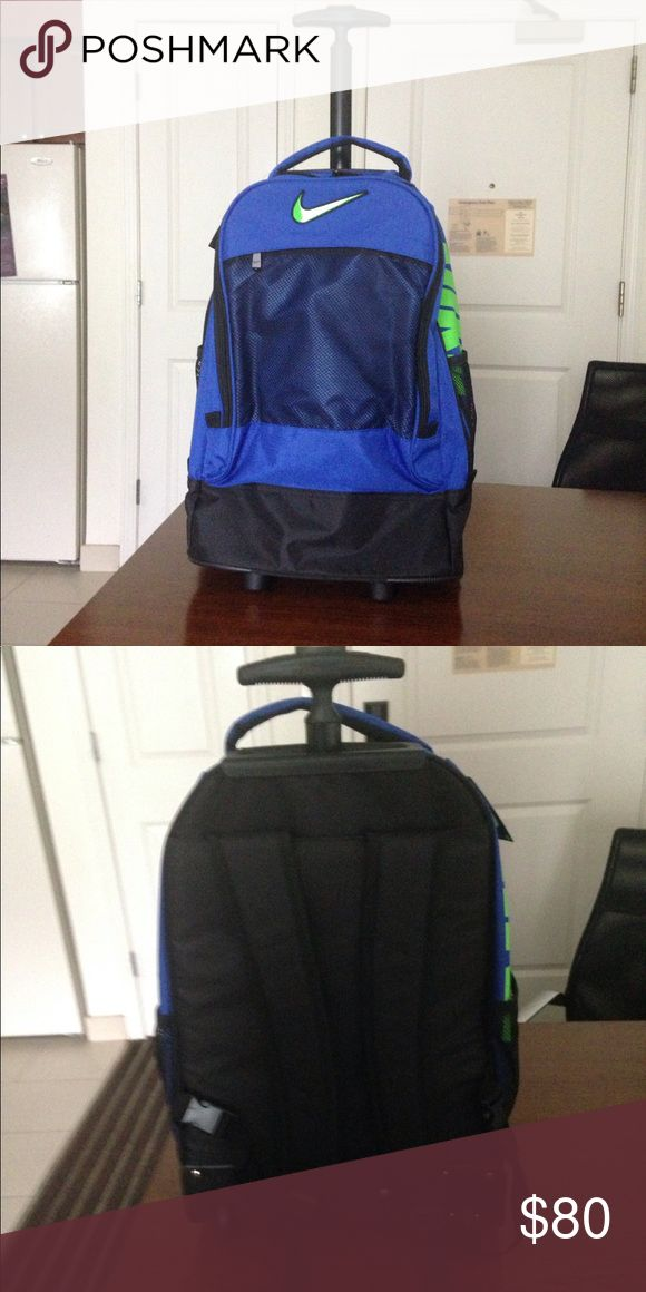 Nike backpack and roll on Brand new a combination of backpack and airplane carry on with wheels Nike Bags Backpacks