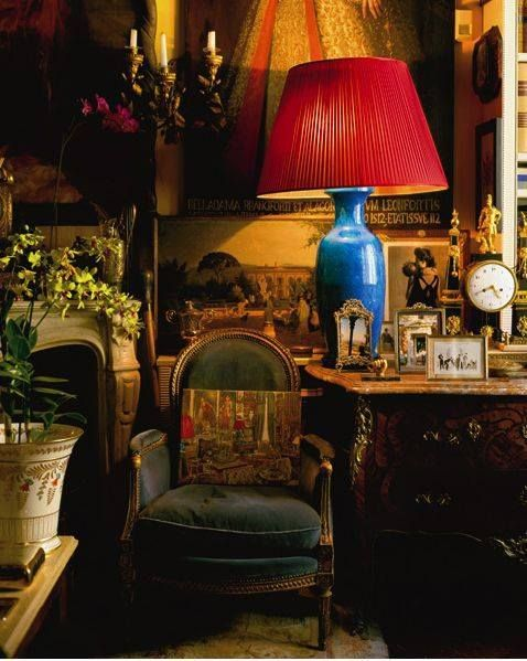 Love a red lamp shade and on a blue lamp it is a great mix of hot and cool…k