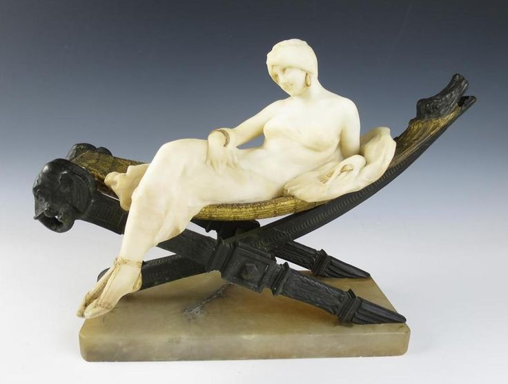 Art Deco era Italian alabaster and bronze sculpture of a harem girl.  The sculptor is Emilio Fiaschi.The base is stone, the frame of the hammock is bronze, and she and the hammock to her right are made of alabaster.  On one end of the hammock frame is a pair of elephant heads, on the other end is a crocodile's head