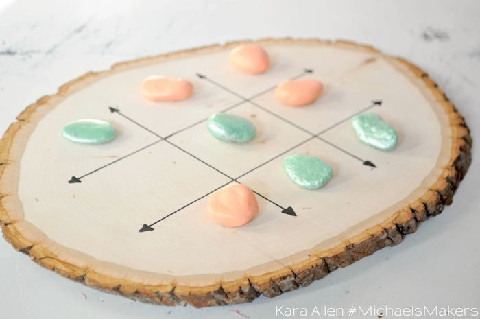 DIY tic tac toe wood + rock game board craft! Via Kara's Party Ideas KarasPartyIdeas.com Perfect for a woodland or camping party activity or favor!