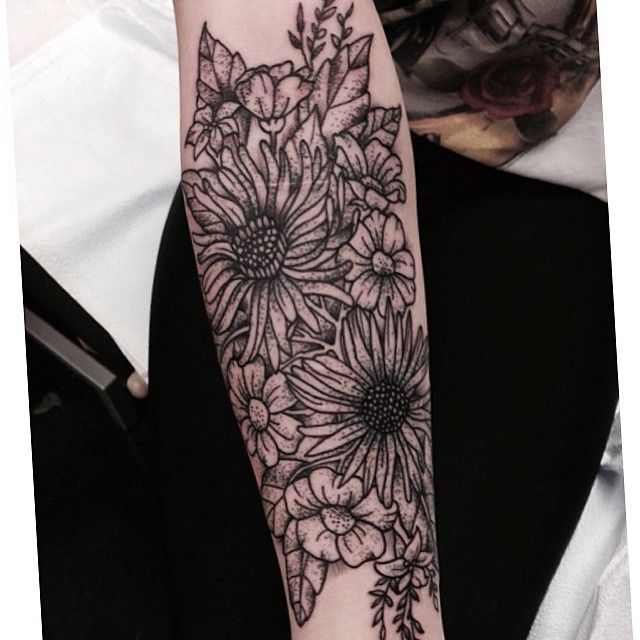 Black and white floral sunflower tattoo over scars by Tara Zep
